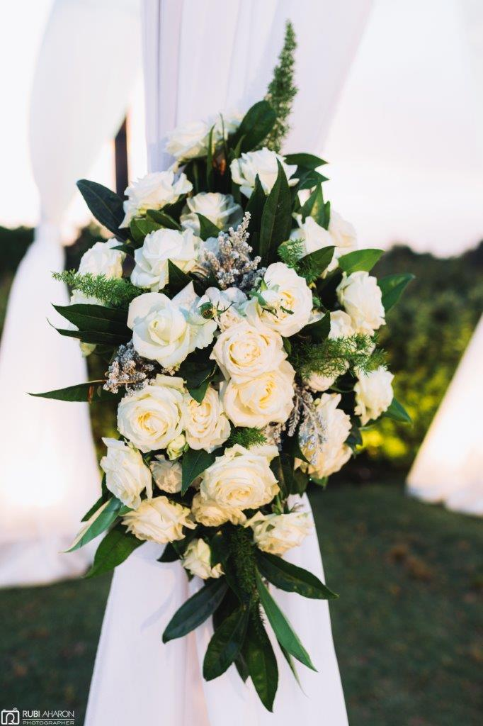 Flowers that decorate a wedding canopy