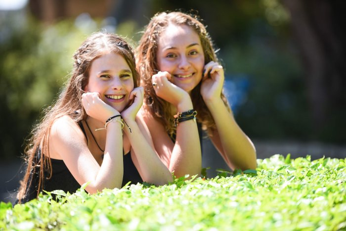 Two girls are smiling